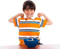 Young little boy showing his strength Stock Images