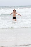 Young little boy in water summer holiday fun sea Stock Photos