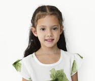 Young little girl with awkward smile expression portrait Stock Photos