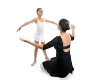 Young little girl ballerina learning dance lesson with ballet teacher. Young little girl ballerina learning dance lesson with female ballet teacher Royalty Free Stock Photography