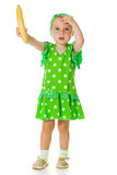 Young little girl with a banana Stock Image
