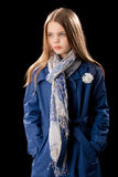 Young little girl in blue coat Royalty Free Stock Image