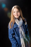 Young little girl in blue coat Stock Image