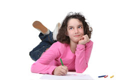 Young Little Girl Coloring and Daydreaming royalty free stock photo