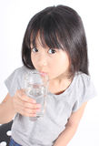 Young little girl drinking water. Stock Images