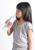 Young little girl drinking water. Royalty Free Stock Photos
