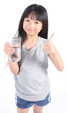 Young little girl drinking water. Young little girl drinking water on white background Stock Photos
