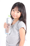 Young little girl drinking water. Stock Photography