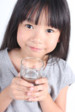 Young little girl drinking water. Royalty Free Stock Photography