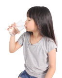 Young little girl drinking water. Royalty Free Stock Image