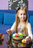 Young little girl with Easter eggs. Young cute little girl with Easter eggs Stock Photography