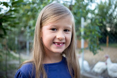 Young little girl without a front tooth stock photo