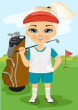Young little girl with a golf club. Standing near brown bag on a field outdoor Royalty Free Stock Photo