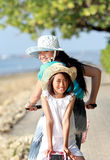 Young little girl having fun with bicycle outdoor Royalty Free Stock Image