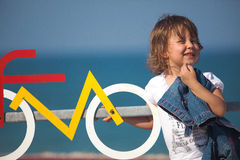 Young little girl having fun next to bicycle lane Royalty Free Stock Photography
