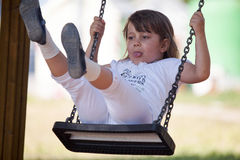 Young little girl having fun in the park Royalty Free Stock Photos