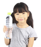Young little girl holding a bottle of water. Royalty Free Stock Images