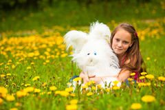 Young little girl holding a soft toy Stock Photography