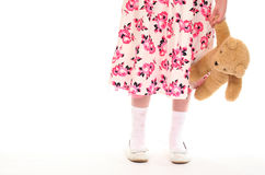 Young little girl holding teddy bear Royalty Free Stock Photos