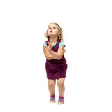 Young little girl jumping over isolated white background Royalty Free Stock Images