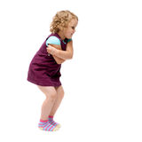 Young little girl jumping over isolated white background Stock Images