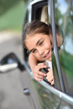 Young little girl leaning her head out of the car Stock Photo