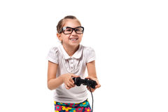 Young little girl play videogame by gamepad. On the white isolated background Royalty Free Stock Image