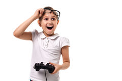 Young little girl play videogame by gamepad. On the white isolated background Stock Photography