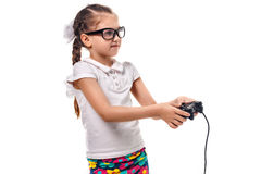 Young little girl play videogame by gamepad Royalty Free Stock Photography