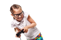 Young little girl play videogame by gamepad. On the white isolated background Stock Photos