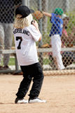 Young little girl playing baseball stock images