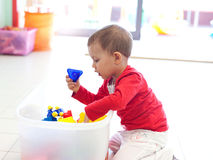 Young little girl playing with toys Stock Photography