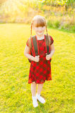 A young little girl preparing to walk to school Royalty Free Stock Photography