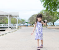 Young little girl shooting camera Stock Images
