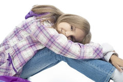 Young little girl sitting bended Stock Photos