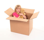 Young little girl sitting inside box Stock Photos