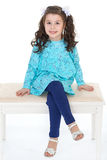 Young little girl sitting. Royalty Free Stock Photos