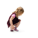 Young little girl sitting over isolated white background Stock Photo