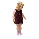 Young little girl standing over isolated white background Stock Photos