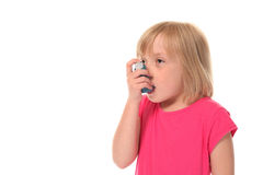 Young little girl using inhaler Royalty Free Stock Photos