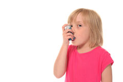 Young little girl using inhaler Royalty Free Stock Photography