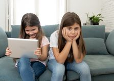 Young little girl using laptop ignoring her angry sad lonely old stock image