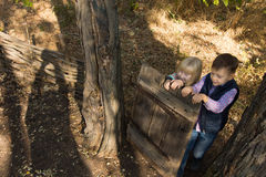 Young Little Kids Playing at the Woodland Royalty Free Stock Photo