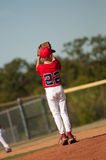 Youth pitcher checking second base Stock Photography