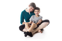Young little son embracing his mother. A nice young little son embracing his mother stock photography