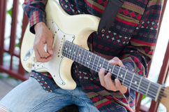 Young Living and practicing electric guitar happily at home. Stock Images