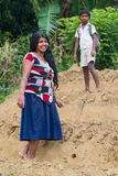 Young local woman and boy stand on tea plantation Royalty Free Stock Photo