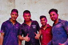 4 young locals enjoy Holi festival in Delhi, India. Royalty Free Stock Images