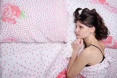 Young lonely girl bored in bed Royalty Free Stock Image