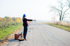 Young lonely woman and baby hitchhiking on rural Royalty Free Stock Images